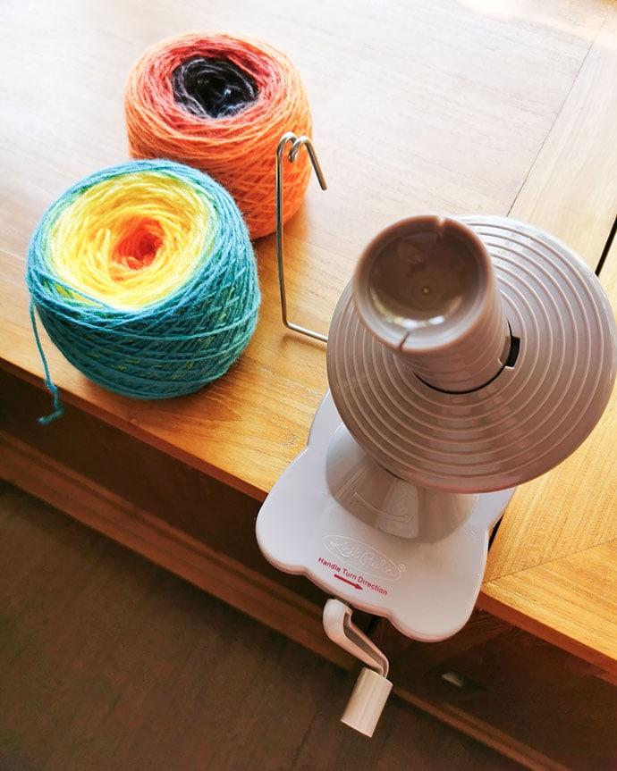 ball winder with 2 balls of yarn