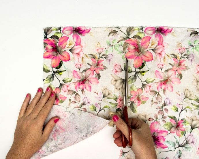 scissors cutting into floral fabric