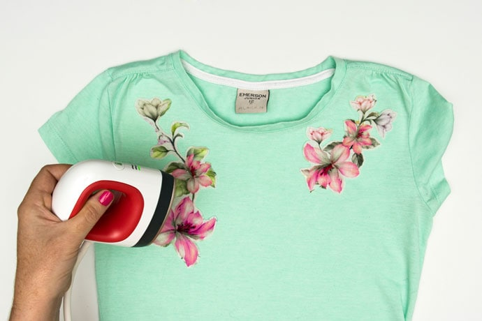 Ironing on floral applique to green tshirt with easy press mini