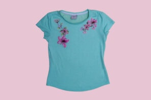 blue tshirt with floral applique on pink background