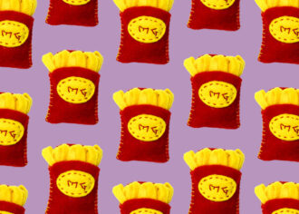 Mini felt french fries in red box on purple background