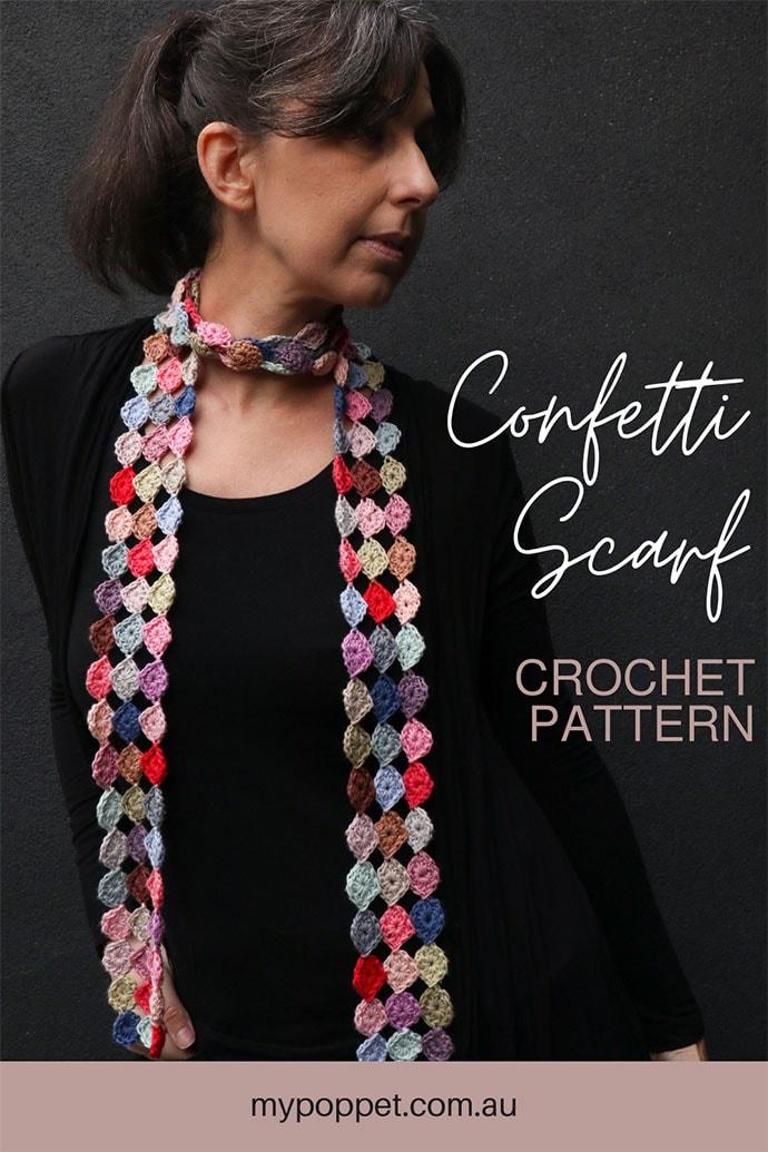 confetti scarf corchet pattern - woman dressed in black wearing spotty crochetscarf