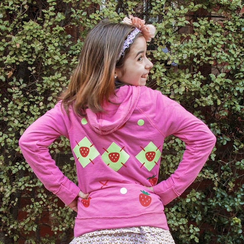 girl wearing pink strawberry shortcake hoodie