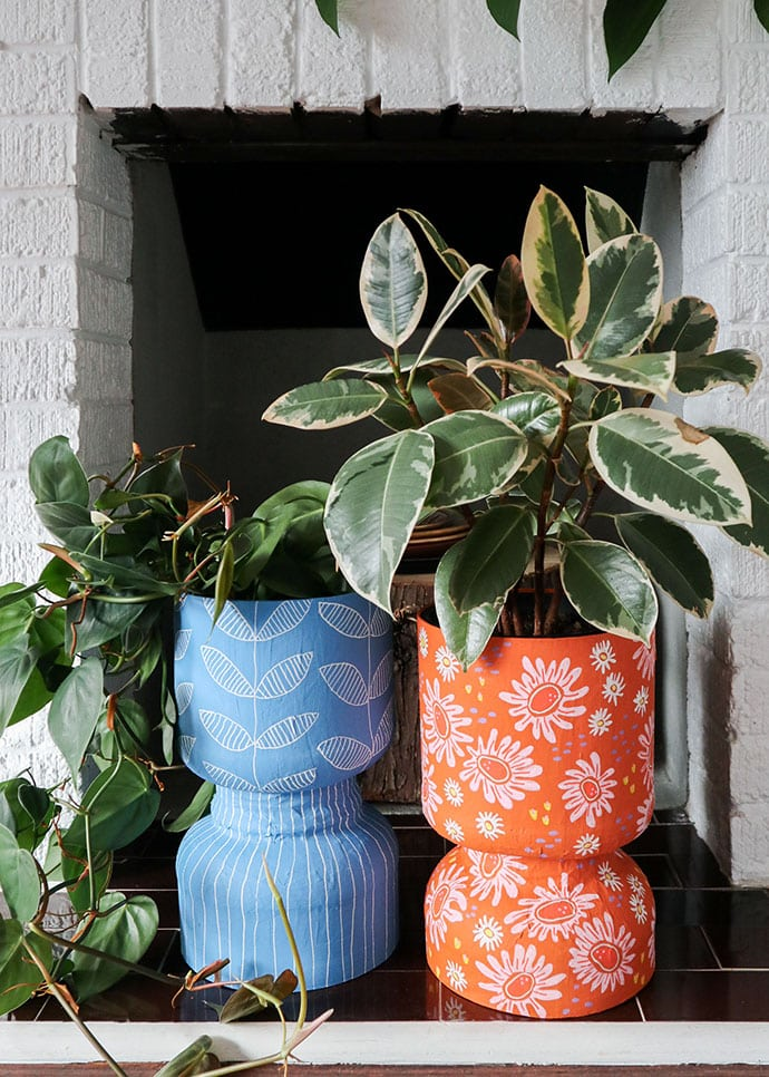 Two Decorative Planters made from recycled protein powder tub