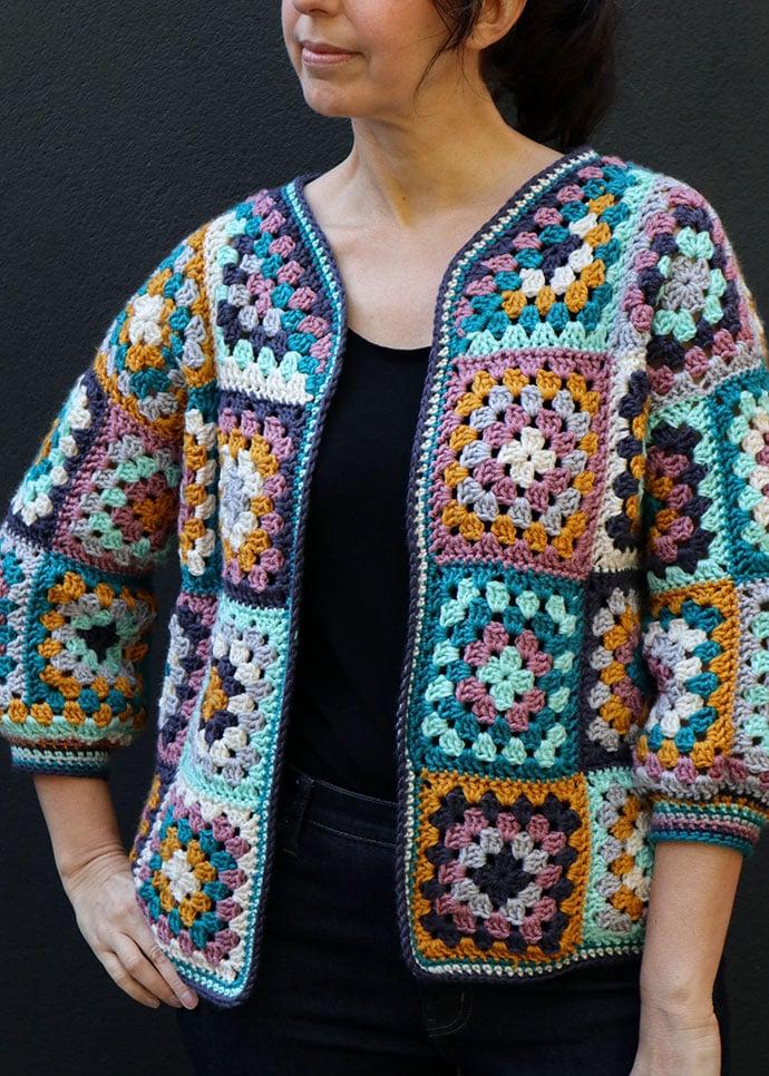 woman torso wearing crochet granny square cardigan