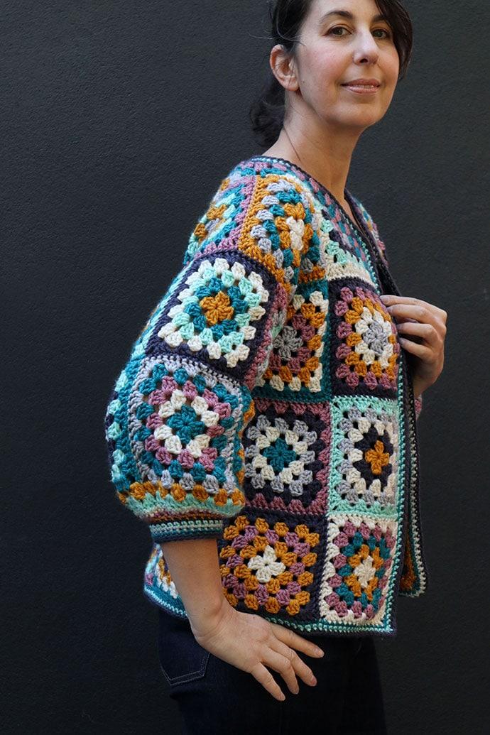woman wearing crochet granny square cardigan