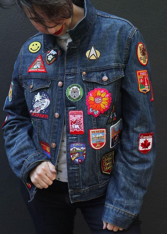 woman wearing vintage patch denim jacket