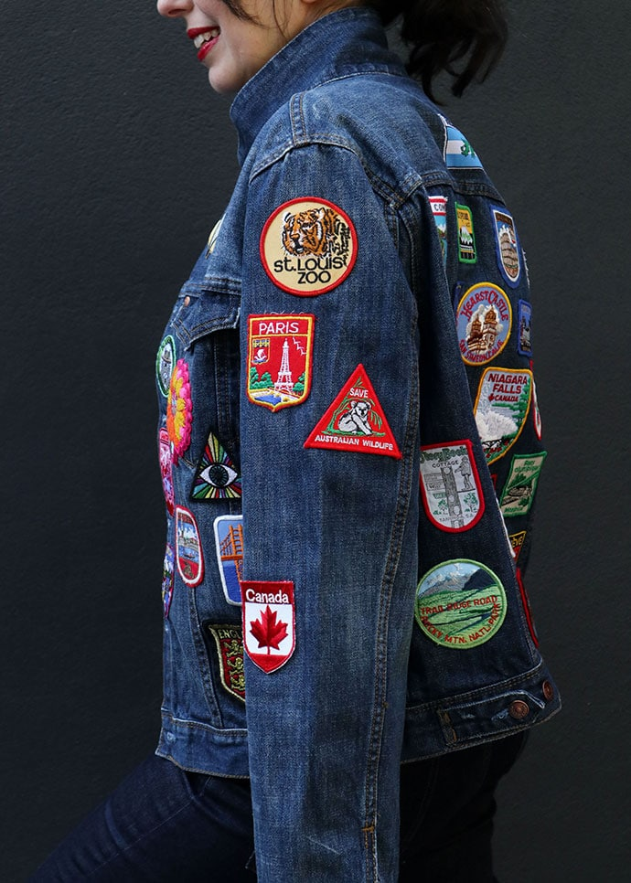 woman wearing denim jacket covered with patches