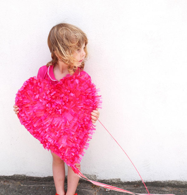 girl holding pink heart paper valentine kite DIY photo prop