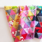 Traingle patchwork quilt top rainbow colours