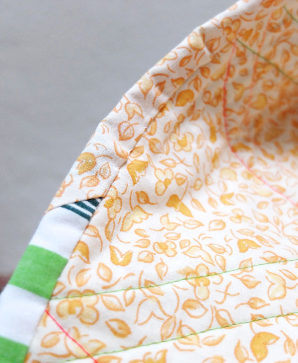 Finished hand stitched quilt binding