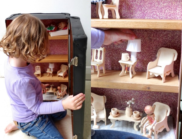 Play with a suitcase dollhouse