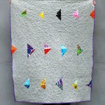 Modern quilt design grey with bright arrows