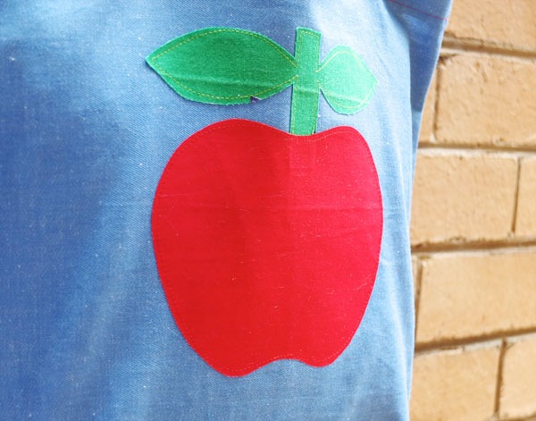 Close up of red apple tote bag