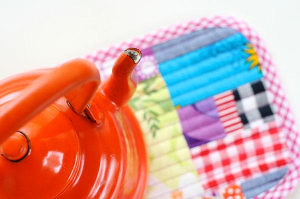 Patchwork and orange kettle Patchwork trivet - scrapbusting project mypoppet.com .au