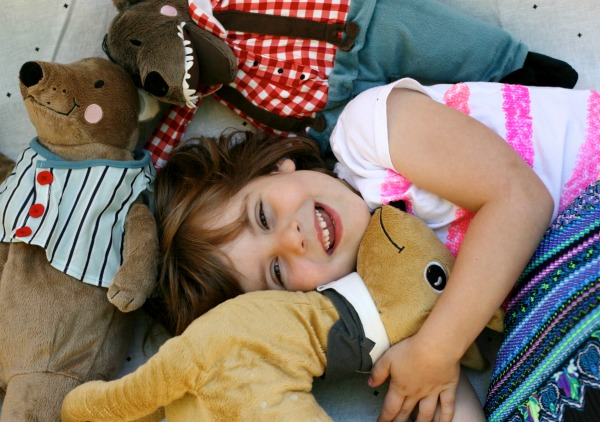 laughing girl surrounded by ikea toys