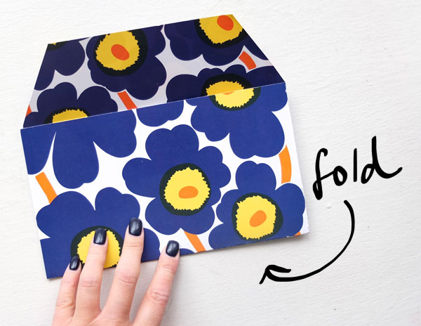 Make an envelope from a recycled magazine cover