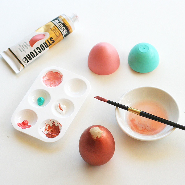 painting wooden Easter eggs