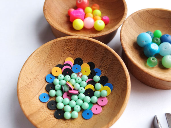 Colourful beads in wooden bowls