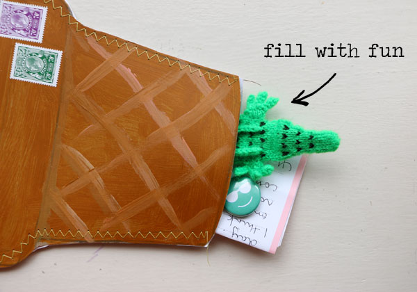 Fill ice cream cone envelope with goodies